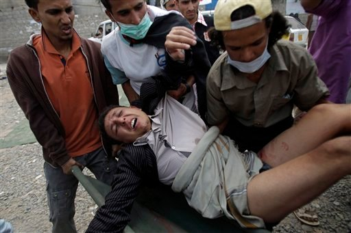 Anti-government protestors carry a wounded protestor from the site of clashes with security forces to a field hospitanl in Sanaa, Yemen, Monday, Sept. 19, 2011. (AP Photo/Hani Mohammed)