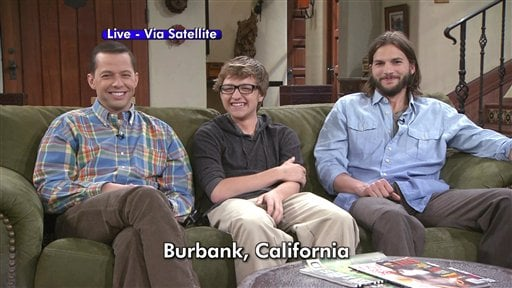 """In this image taken from video and provided by CBS, the co-stars of """"Two and a Half Men"""" from left, Jon Cryer, Angus T. Jones and Ashton Kutcher, appear on satellite from California."""