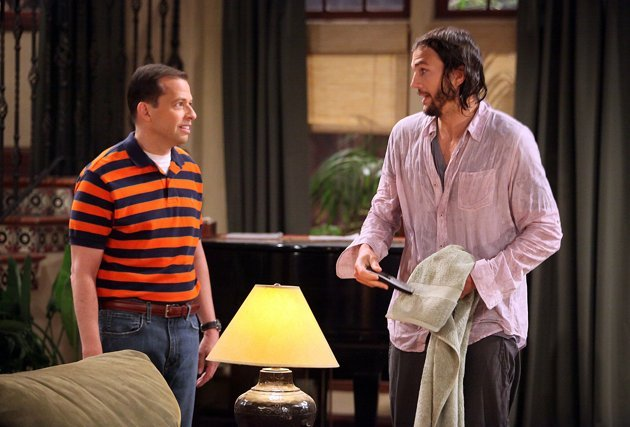 """In this image released by CBS, Jon Cryer portrays Alan Harper, left, and Ashton Kutcher portrays Walden Schmidt in Kutcher's debut on the CBS comedy """"Two and a Half Men,"""" which aired Monday, Sept. 19, 2011."""