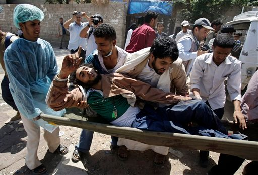 Yemeni anti-government protestors carry an injured protestor from the site of clashes with security forces, in Sanaa, Yemen Sept. 20, 2011.(AP Photo/Hani Mohammed)