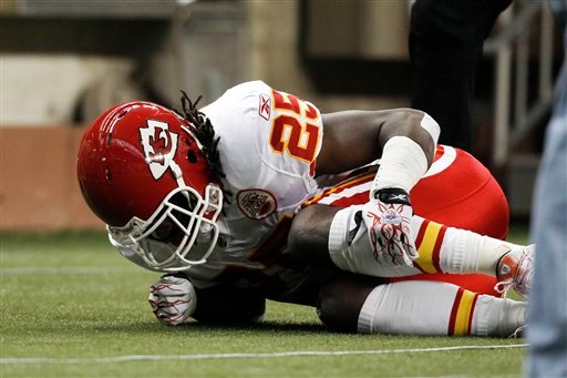Kansas City Chiefs running back Jamaal Charles (25) grabs his leg after being injured on a play in the first quarter of an NFL football game against the Detroit Lions in Detroit, Sunday, Sept. 18, 2011.