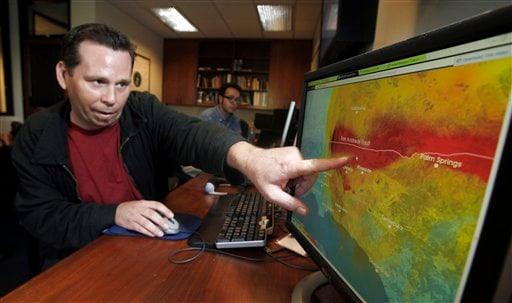 This Sept. 13, 2011 photo shows Anthony Guarino Jr., a seismic analyst at the California Institute of Technology, demonstrating an early earthquake warning system in Pasadena, Calif. (AP Photo/Reed Saxon)