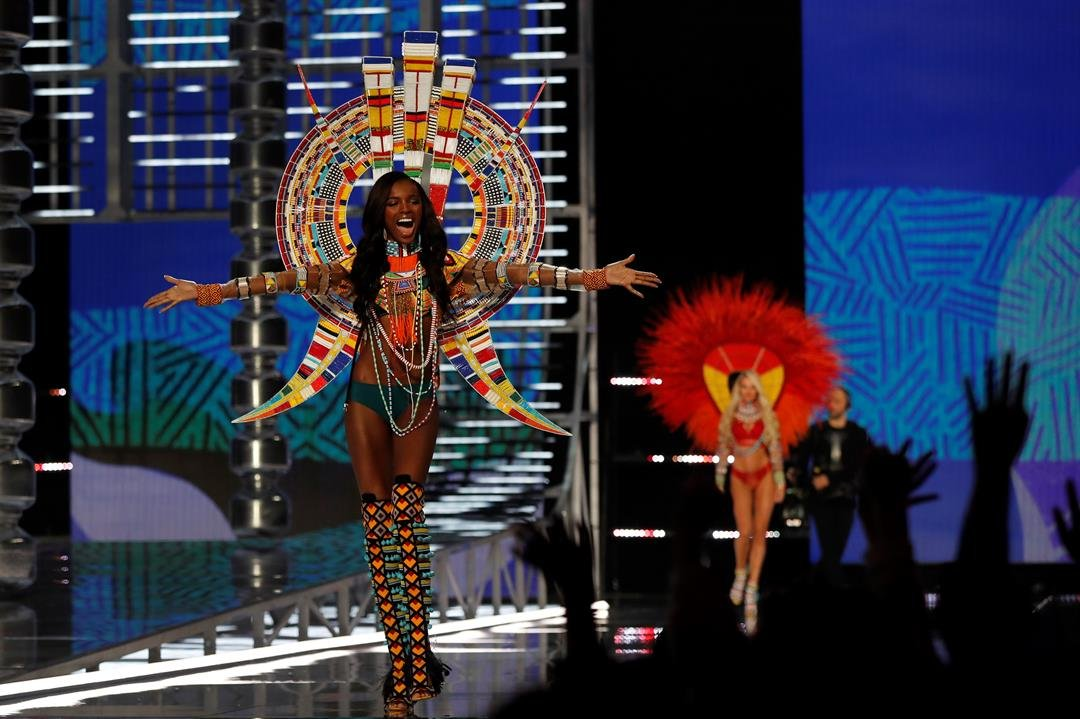 British model Leomie Anderson cheers Chinese fans as she presents a creation during the Victoria's Secret fashion show at the Mercedes-Benz Arena in Shanghai, China on Monday, Nov. 20, 2017. (AP Photo/Andy Wong)