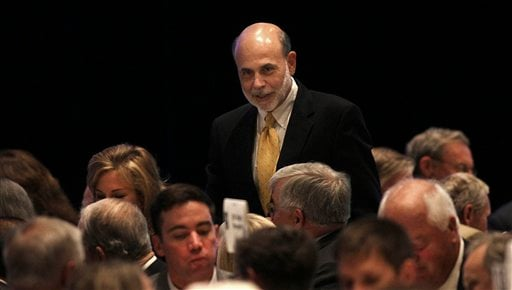 Ben Bernanke speaks with some of the business people in attendance at the event prior to his speech, Thursday, Sept. 8, 2011 in Minneapolis. (AP Photo/The Star Tribune, Jim Gehrz)
