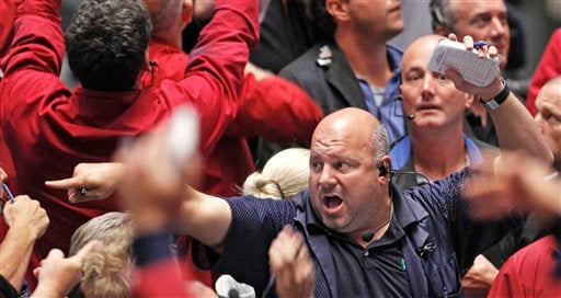 Traders work in the S&P 500 Futures pit at the CME Group in Chicago Sept. 21, 2011, as the Federal Reserve announced it will use more than $400 billion to try to drive down long-term interest rates. (AP Photo/M. Spencer Green)