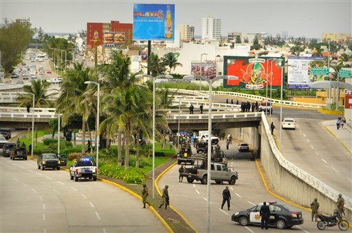 Soldiers and police block off an area where 35 bodies lay under an overpass in Veracruz, Mexico, Tuesday Sept. 20, 2011. (AP Photo)