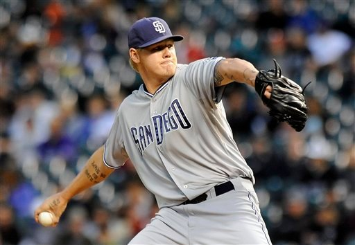 San Diego Padres starting pitcher Mat Latos throws in the first inning of a baseball game against the Colorado Rockies on Tuesday, Sept. 20, 2011 in Denver. (AP Photo/Chris Schneider)