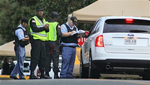 Lawyers for Troy Davis in car are turned away at the Georgia Diagnostic Prison Sept. 21, 2011 as they tried to gain access to give a polygraph test to Troy Davis before he is scheduled to be executed. (AP Photo/Atlanta Journal-Constitution, John Spink)