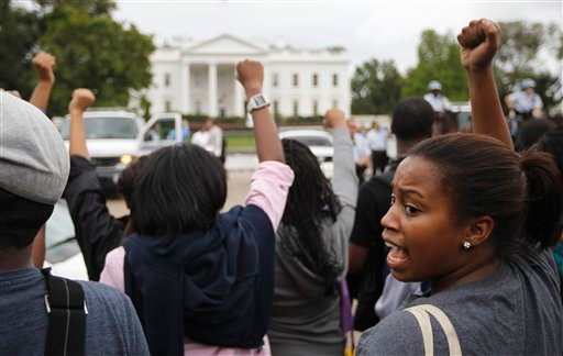 Demonstrators gather in front of the White House in Washington, Wednesday, Sept. 21, 2011, as they protest the planned execution of death row inmate Troy Davis. (AP Photo/Charles Dharapak)