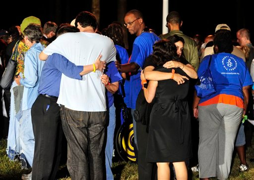 Anti-death penalty supporters comfort each other after hearing that the U.S. Supreme Court rejected a last minute plea of Georgia death row inmate Troy Davis In Jackson, Ga., Wednesday, Sept. 21, 2011. (AP/Photo Stephen Morton)