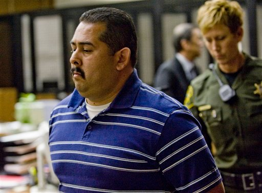 Fullerton police officer Manuel Ramos is taken into custody after being arraigned in Orange County Superior Court on Wednesday, Sept. 21, 2011 in Santa Ana, Calif.