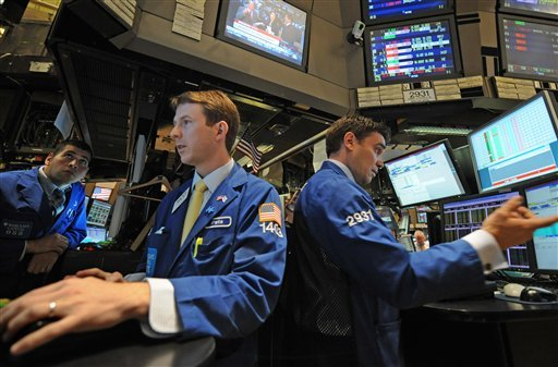 Traders work on the floor of the New York Stock Exchange,Thursday, Sept. 22, 2011, in New York. (AP Photo/ Louis Lanzano)