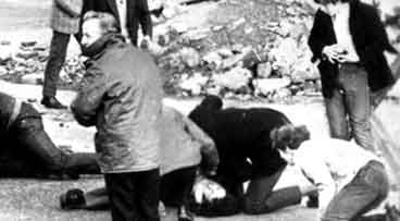 This is a Sunday Jan. 30, 1972 file photo of a man receiving attention during the shooting incident in Londonderry, Northern Ireland, which became known as Bloody Sunday. (AP Photo/PA, File)