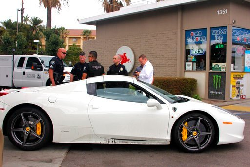 This undated photo provided by the Santa Ana Police Department shows a stolen Ferrari that was reclaimed by police in Santa Ana, Calif. A Southern California man suspected of stealing the $300,000 Ferrari was arrested after asking for gas money, authoriti