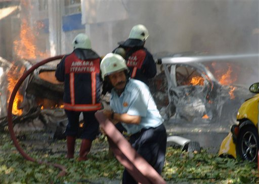 Firefighters are seen working at the site after a suspected car bomb exploded in a busy street in the Turkish capital Ankara, Turkey Sept. 20, 2011, killing three people and wounding 15 others, authorities said. (AP Photo)