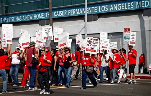 Kaiser Permanente employees walkout to protest proposed benefit cuts and a lack of progress on contract talks outside the Kaiser Permanente hospital Wednesday, Sept. 21, 2011, in Los Angeles.