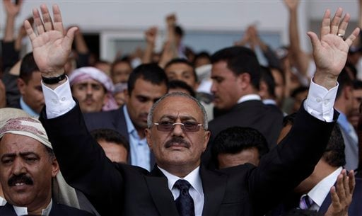 In this April 15, 2011 file photo, Yemeni President Ali Abdullah Saleh waves to his supporters, not pictured, during a rally in Sanaa,Yemen. (AP)