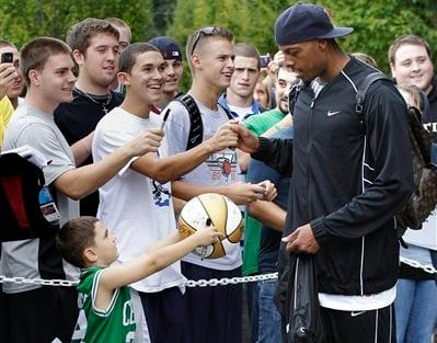 This Sept. 28, 2010, file photo shows Boston Celtics fan Justin Taylor Jr., 5, of Fall River, Mass., holds up a basketball to be autographed as Celtics forward Paul Pierce is greeted by students after their practice at NBA basketball training camp (AP).
