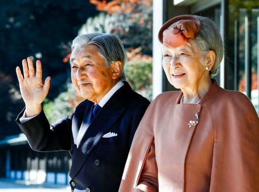 Japan's Emperor Akihito waves with Empress Michiko to Luxembourg's Grand Duke Henri after their meeting at the Imperial Palace in Tokyo Monday, Nov. 27, 2017. (Kimimasa Mayama/Pool Photo via AP)
