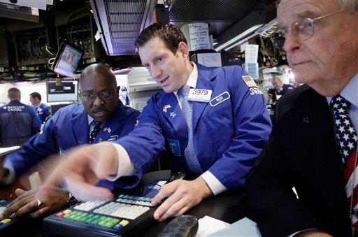 Working for Barclays Capital are Vincent Folds, left, William Bott, center, and James Maguire, right, at the New York Stock Exchange, Friday, Sept. 23, 2011 in New York.