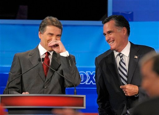 Republican presidential candidates Texas Gov. Rick Perry, left, and former Massachusetts Gov. Mitt Romney, share a laugh during a Fox News/Google debate Thursday, Sept. 22, 2011, in Orlando, Fla.