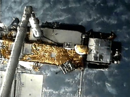 This screen grab image provided by NASA shows UARS attached to the robotic arm of the space shuttle Discovery during mission STS-48 in 1991, when UARS was deployed. (AP)