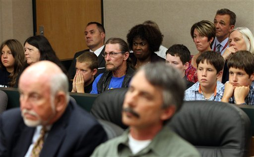 Tacoma schools' superintendent Art Jarvis, foreground left, sits with members of the school board including board president Kurt Miller, right, in Superior Court where Judge Bryan Chushcoff is deciding whether to order the striking teachers back to work.