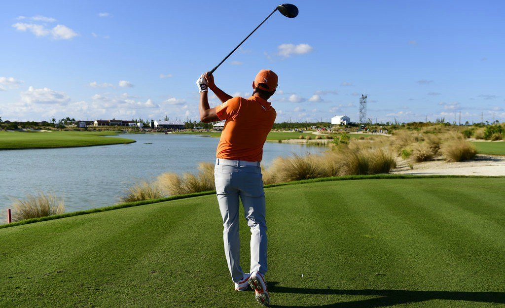 Rickie Fowler watches his shot from the 18th tee during the final round of the Hero World Challenge golf tournament at Albany Golf Club in Nassau, Bahamas, Sunday, Dec. 3, 2017. Fowler won the tournament. (AP Photo/Dante Carrer)