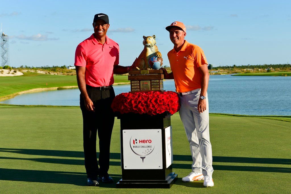 Rickie Fowler, right, poses with Tiger Woods and the trophy after Fowler won the Hero World Challenge golf tournament at Albany Golf Club in Nassau, Bahamas, Sunday, Dec. 3, 2017. (AP Photo/Dante Carrer)