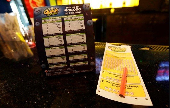 Quick Draw lotto sheet is seen on the bar at the William Hill Sports Bar inside Monmouth Park racetrack in West Long Branch, N.J.