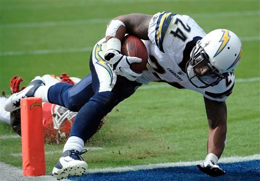 San Diego Chargers running back Ryan Mathews gets past Kansas City Chiefs defensive back Travis Daniels as he scores a touchdown in the second half of an NFL football game Sunday, Sept. 25, 2011, in San Diego. The Chargers won 20-17.