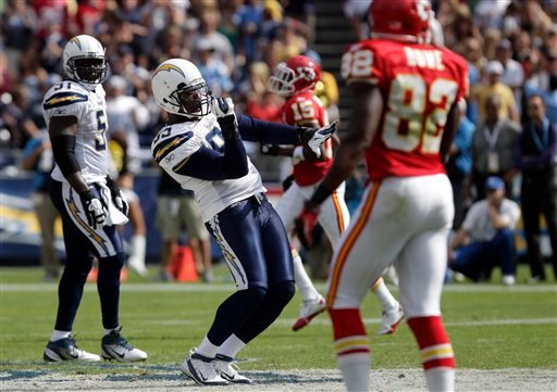 San Diego Chargers outside linebacker Shaun Phillips celebrates his sack on Kansas City Chiefs quarterback Matt Cassel (not pictured) as teammate inside linebacker Takeo Spikes, right, looks on in the second half of an NFL football game.