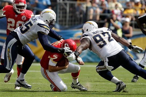 Kansas City Chiefs quarterback Matt Cassel is sacked by San Diego Chargers defensive end Vaughn Martin (92) , and outside linebacker Shaun Phillips (95).