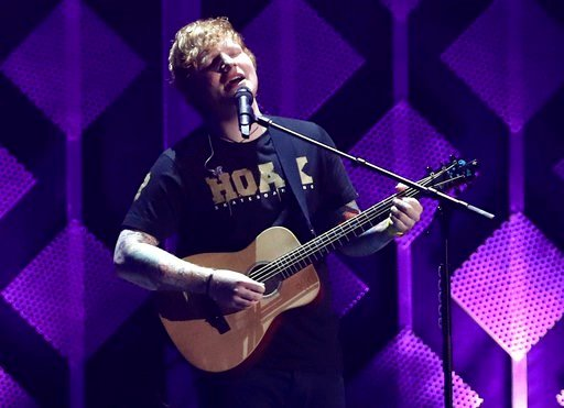 FILE - In this Dec. 1, 2017, file photo, Ed Sheeran performs at Jingle Ball at The Forum in Inglewood, Calif. (Photo by John Salangsang/Invision/AP, File)