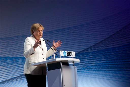 German Chancellor Angela Merkel delivers a speech at the annual conference of the Federation of German Industry (BDI) in Berlin, central Germany, Tuesday, Sept. 27, 2011. (AP)