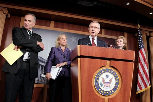 From left, Sen. Chuck Schumer, D-N.Y., Sen. Mary Landrieu, D-La., Senate Majority Leader Harry Reid, D-Nev., and Sen. Debbie Stabenow, D-Mich., meet with reporters following the vote on a short term funding bill on Capitol Hill in Washington (AP)