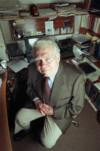 """FILE - In this June 19, 1998 file photo, commentator Andy Rooney, of CBS-TV's """"60 Minutes,"""" poses in his office at CBS in New York. CBS announced Tuesday, Sept. 27, 2011 that Rooney will make his final appearance on """"60 Minutes,"""" on Sunday's broadcast."""