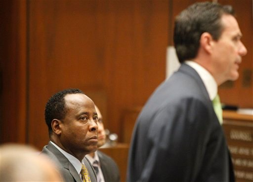 Conrad Murray watches his attorney, Edward Chernoff, question concert promoter Paul Gongaware on the second day of his involuntary manslaughter trial in the death of pop star Michael Jackson in downtown Los Angeles, Wednesday, Sept. 28, 2011.