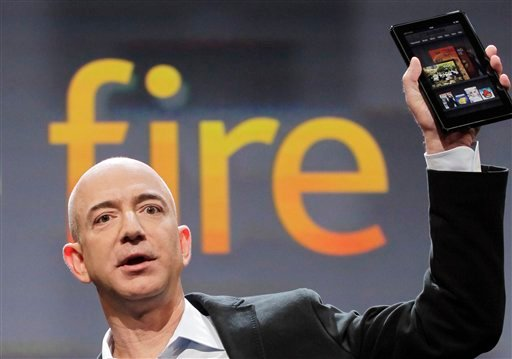 Jeff Bezos, Chairman and CEO of Amazon.com, introduces the Kindle Fire at a news conference, Wednesday, Sept. 28, 2011 in New York. The e-reader and tablet has a 7-inch (17.78 cm) multicolor touchscreen.