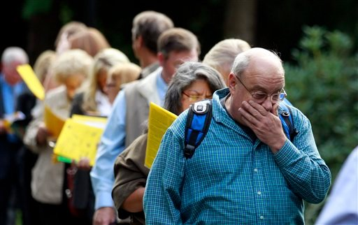 Jay Kober, 60, of Portland, who has been unemployed for 10 months, waits in line with others during the 2011 Maximum Connections Job and Career Fair Thursday, Sept. 15, 2011, in Portland, Ore.