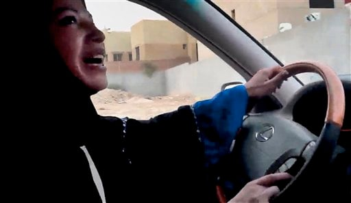 FILE - In this Friday, June 17, 2011 file image made from video released by Change.org, a Saudi Arabian woman drives a car as part of a campaign to defy Saudi Arabia's ban on women driving, in Riyadh, Saudi Arabia.