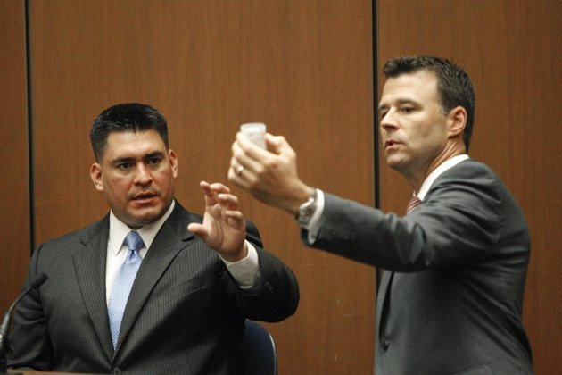 Deputy District. Attorney. David Walgren, holding a bottle of propofol, questions Alberto Alvarez, one of Michael Jackson's security guards, during Conrad Murray's involuntary manslaughter trial in downtown Los Angeles, Thursday, Sept. 29, 2011.