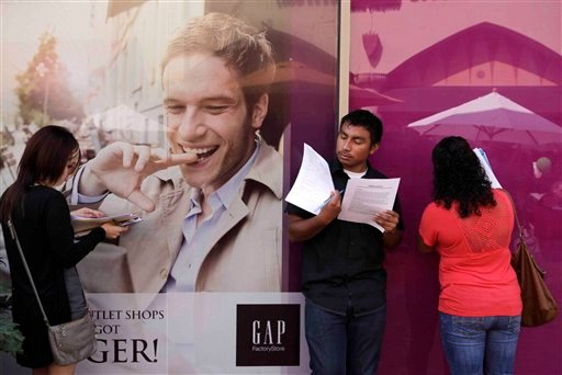 Job seekers fill out applications during a job fair at the Citadel Outlets in Commerce, Calif., Wednesday, Sept. 21, 2011.