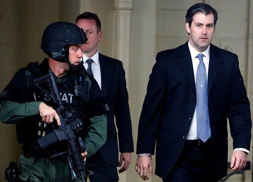 former South Carolina officer, Michael Slager, right, walks from the Charleston County Courthouse.