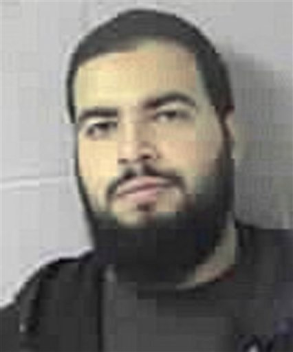 This Wednesday, Oct. 21, 2009, file booking photo released by the Sudbury, Mass., police department shows Tarek Mehanna, of Sudbury, after he was arrested and charged with conspiring to plot terror attacks.