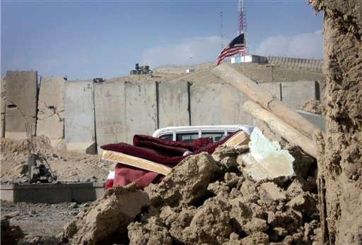 Debris is seen outside Combat Outpost Sayed Abad in eastern Wardak province of Afghanistan on Sunday, Sept. 11, 2011.
