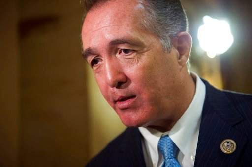 FILE - In this March 24, 2017, file photo, Rep. Trent Franks, R-Ariz. speaks with a reporter on Capitol Hill in Washington. (AP Photo/Cliff Owen, File)