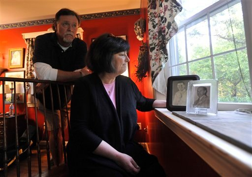 Donna Kay Wells Lloyd and her brother Clarence William Wells look out the window as photographs of their father, Clarence Wells, are displayed Friday, Sept. 30, 2011 in Catonsville, Md. Donna Kay Wells Lloyd says her father, Clarence Wells, died Aug. 31.