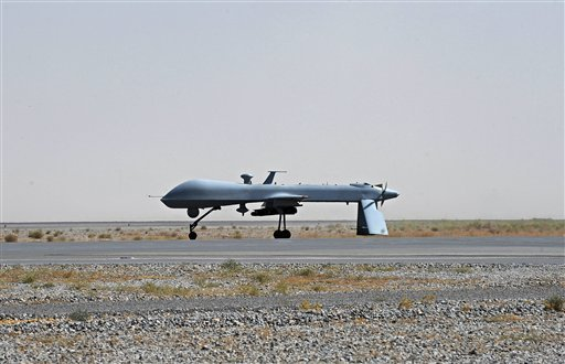 In this June 13, 2010, file photo a U.S. Predator unmanned drone armed with a missile stands on the tarmac of Kandahar military airport in Afghanistan. (AP)