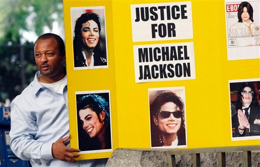 Activist Najee Ali, demonstrates outside court Thursday Sept. 8, 2011 where jury selection has begun for the trial of Conrad Murray, Michael Jackson's doctor, who has been charged with involuntary manslaughter in the pop icon's death, in Los Angeles. (AP)
